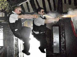 Simon Pegg (left) and Nick Frost spoof action movies in thi year's fast-paced Hot Fuzz. LOWER LEFT: Mike Myers as Austin Powers.