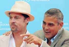 Brad Pitt and George Clooney ham it up for the cameras in Venice